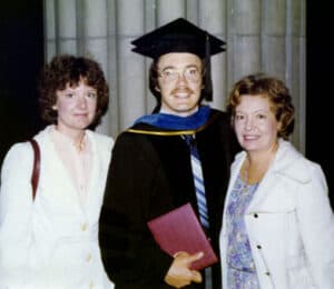 Hollinger receiving his doctoral degree March 17, 1979, with his wife, Candy (left), and his mother, Eleanor (right).