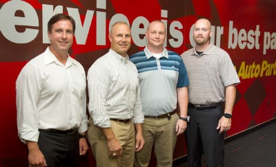 (Left to right) Protos Security's cofounders, Chris Copenhaver and Patrick Henderson, and Advance Auto Parts' Marc Patrouch, manager of asset solutions and analytics, and Jeff Carr, asset protection solutions engineer.