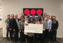 Securitas Stand Up to Cancer check donation
