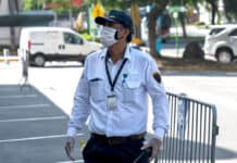Security guard with mask and gloves