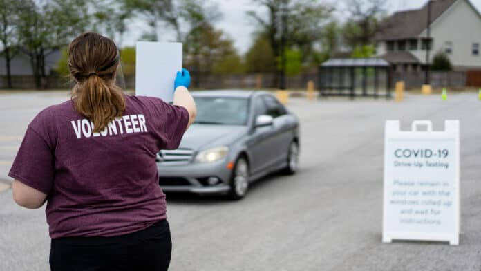 Walmart employee volunteer at drive-up testing site