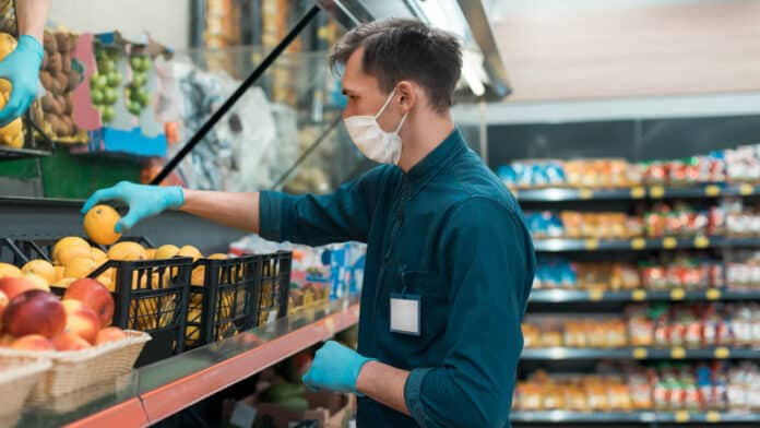 store employee in mask and gloves